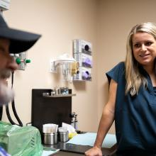 Patient Patrick Fletcher discusses diabetes management with nurse Lindsey Holden, FNP, AG-ACNP.